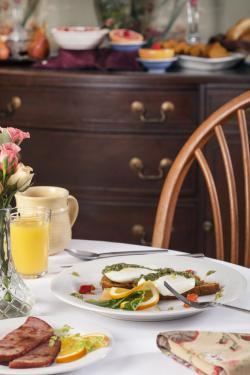 Breakfast Table with Juice and poached eggs with Pesto