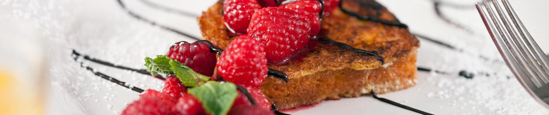 French Toast with Raspberries and Chocolate Sauce